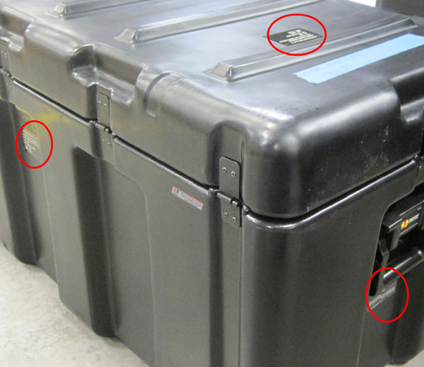 GCS System Numbers can be found on the cases that the system is transported in. The labels can be found on all sides on the case (except the bottom) as highlighted in the pictures below.